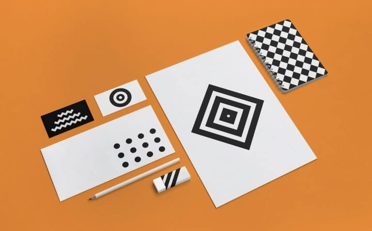 orange background. black and white papers.